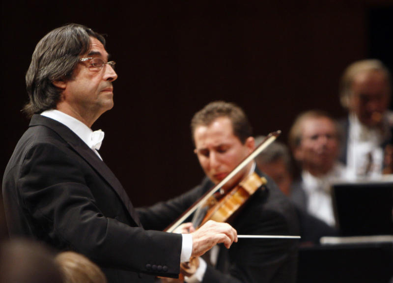 "FILE - This Sept. 8, 2008 file photo shows Maestro Riccardo Muti leading the Vienna Philharmonics, in Lucerne, Switzerland. It isn't every day that a conductor concedes an encore for an opera chorus. Even rarer is asking the audience to sing it, but maestro Riccardo Muti has just done so for the love of homeland. Muti swirled about on his podium late Saturday, March 12, 2011 to face the audience during Giuseppe Verdi's ""Nabucco'' at Rome's Teatro dell'Opera when shouts of ""bis!'' (encore!) rang out.  (AP Photo/Keystone, Sigi Tischler, file)"
