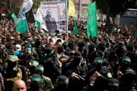 FILE PHOTO: Palestinian members of Hamas' armed wing take part in the funeral of senior militant Mazen Fuqaha in Gaza City March 25, 2017. REUTERS/Mohammed Salem/File Photo