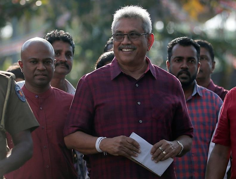 Sri Lanka People's Front party presidential election candidate and former wartime defence chief Rajapaksa leaves after casting his vote during the presidential election in Colombo