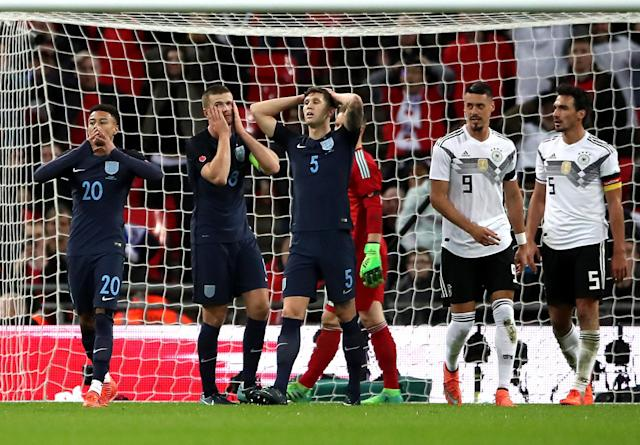 England's Jesse Lingard (left), Eric Dier and John Stones (centre) react after a missed chance
