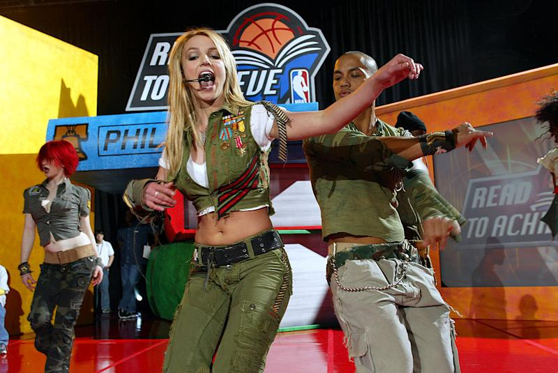 9 Feb 2002: Britney Spears performs during the NBA All -Star Read to Achieve Celebration in Philadelphia, Pennsylvania. DIGITAL IMAGE. NOTE TO USER: User expressly acknowledges and agrees that, by downloading and/ or using this Photograph, User is consenting to the terms and conditions of the Getty Images License Agreement. Mandatory copyright notice: Copyright 2002 NBAE. Mandatory credit :Greg Shamus/NBAE/Getty Images.