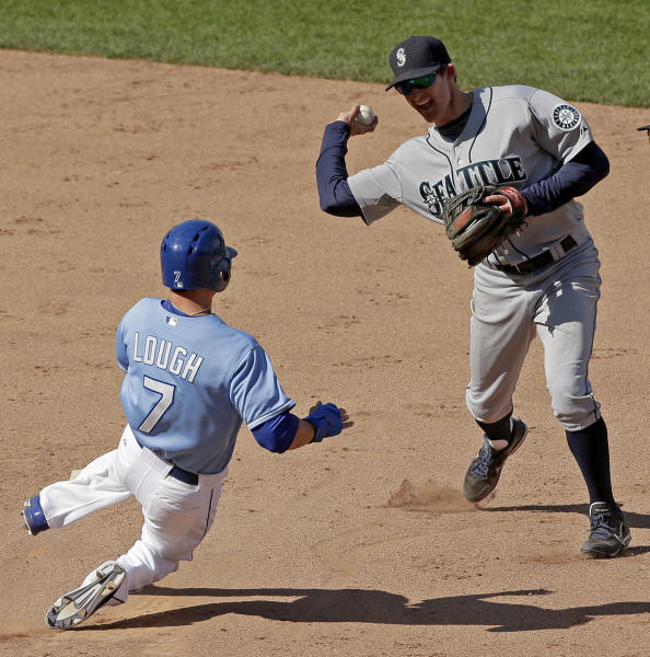Seattle Mariners shortstop Brad Miller, right, throws to first for the double play hit into by Kansas City Royals' Jarrod Dyson after forcing David Lough (7) out at second to end the ninth inning of a baseball game on Thursday, Sept. 5, 2013, in Kansas City, Mo. (AP Photo/Charlie Riedel)