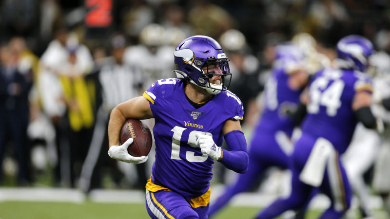 Minnesota Vikings wide receiver Adam Thielen (19) suffered a cut that required stitches. (AP Photo/Brett Duke)