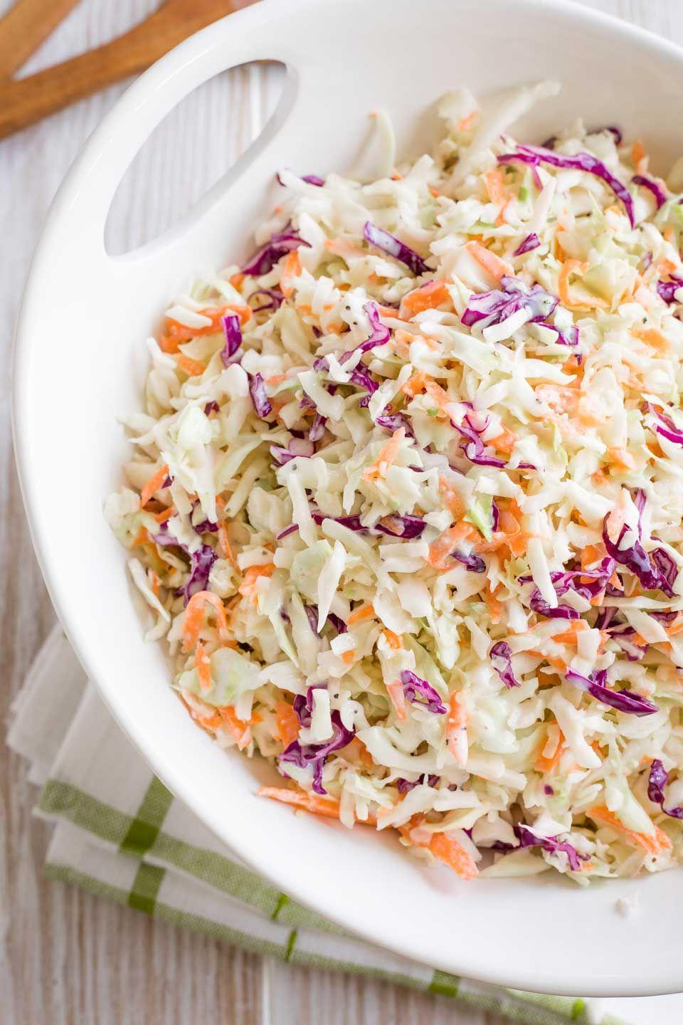 """<p>This recipe is proof that you don't have to slather summer salads—even classics like coleslaw—in mayo for them to be totally irresistible. </p><p><a href=""""https://twohealthykitchens.com/greek-yogurt-coleslaw/"""" rel=""""nofollow noopener"""" target=""""_blank"""" data-ylk=""""slk:Get the recipe."""" class=""""link rapid-noclick-resp"""">Get the recipe. </a></p>"""