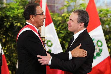 Peru's President Martin Vizcarra and new Prime Minister Salvador del Solar react during the swearing-in ceremony at the government palace in Lima, Peru March 11, 2019. REUTERS/Guadalupe Pardo