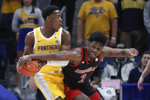 Louisville's Darius Perry (2) reaches for the ball held by Pittsburgh's Xavier Johnson during the first half of an NCAA college basketball game Tuesday, Jan. 14, 2020, in Pittsburgh. (AP Photo/Keith Srakocic)