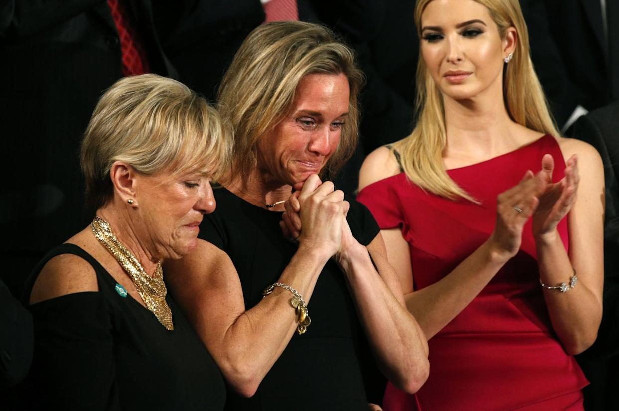 "Carryn Owens (center), widow of William ""Ryan"" Owens, applauds with Ivanka Trump (right), after being mentioned by President Trump. (Photo: Kevin Lamarque/Reuters)"