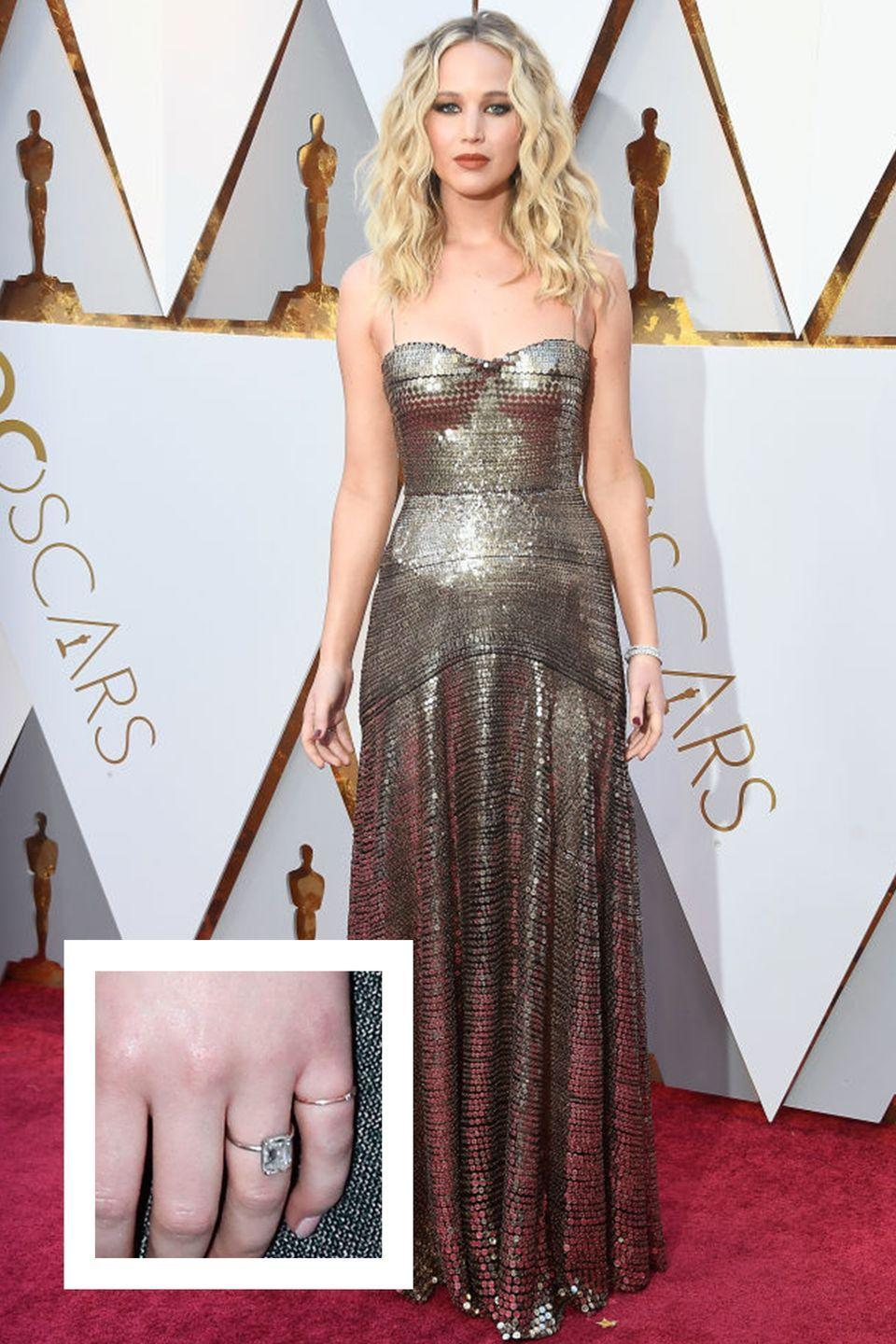 """<p>The actress got engaged to<a href=""""https://www.townandcountrymag.com/the-scene/weddings/a26190886/who-is-cooke-maroney-jennifer-lawrence/"""" rel=""""nofollow noopener"""" target=""""_blank"""" data-ylk=""""slk:art dealer Cooke Maroney"""" class=""""link rapid-noclick-resp""""> art dealer Cooke Maroney</a> in February 2019. A few weeks later, Lawrence debuted <a href=""""https://www.townandcountrymag.com/style/jewelry-and-watches/a26535238/jennifer-lawrence-cooke-maroney-engagement-ring-worth-cost-details/"""" rel=""""nofollow noopener"""" target=""""_blank"""" data-ylk=""""slk:her massive engagement ring"""" class=""""link rapid-noclick-resp"""">her massive engagement ring</a>, which appears to feature a four to five carat elongated cushion or emerald cut diamond center stone in a white gold or platinum solitaire setting. The ring is estimated to cost between $60,000 to $100,000, approximately.</p>"""
