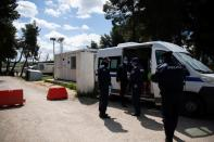 Police officers wearing protective face masks secure the entrance of the Ritsona migrant camp after authorities found 20 coronavirus cases and placed the camp under quarantine, following the outbreak of coronavirus disease (COVID-19), in Ritsona