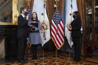 Vice President Kamala Harris, right, ceremonially swears-in Antony Blinken, left, as Secretary of State, next to his wife Evan Ryan, Wednesday Jan. 27, 2021, in Harris' ceremonial office in the Eisenhower Executive Office Building on the White House complex in Washington. (AP Photo/Jacquelyn Martin)