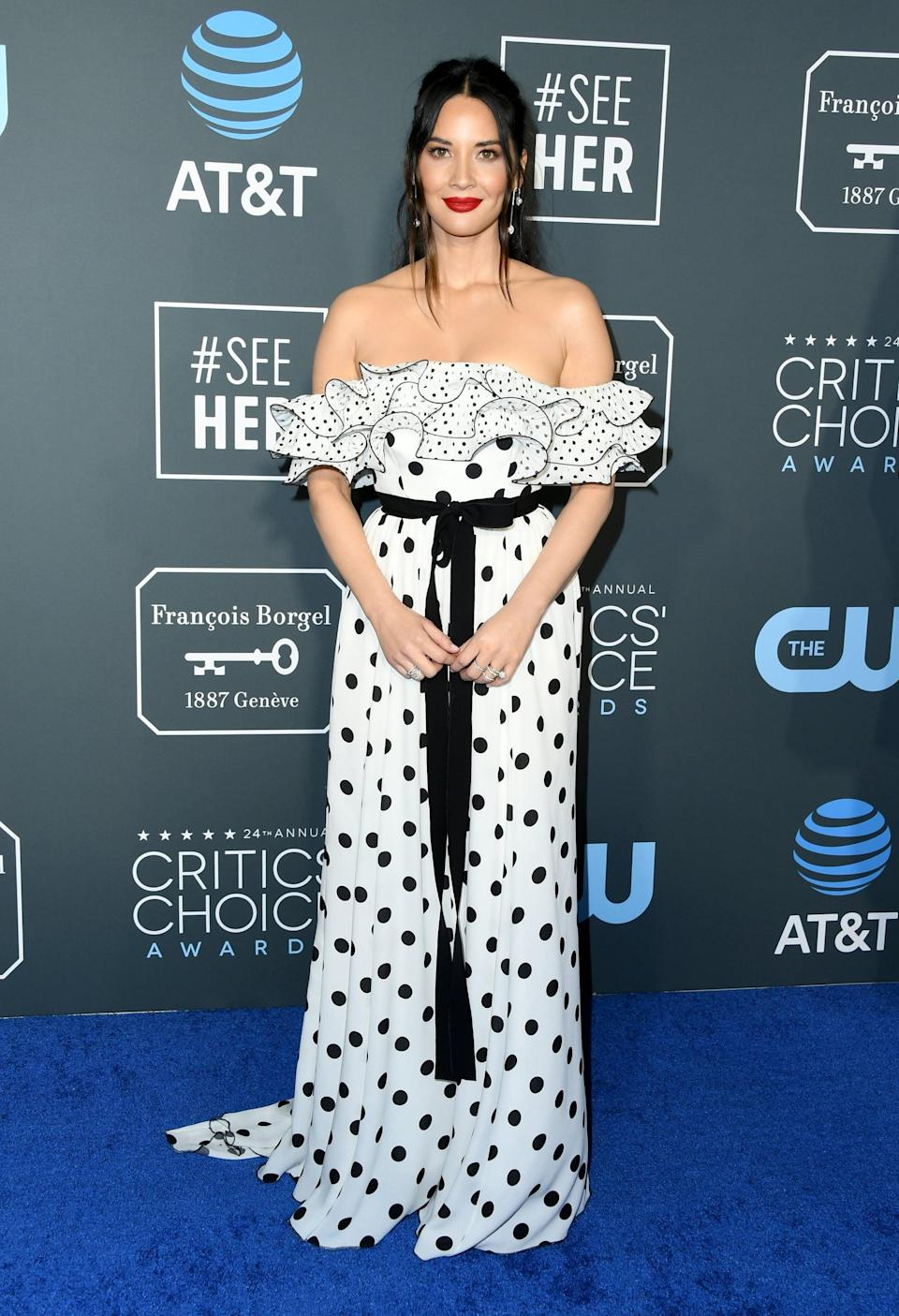 <p>Olivia Munn wearing a polka-dot Andrew Gn gown with jewels by State Property, Eriness, and Stephen Webster. She finished her look off with Jimmy Choo heels.</p>