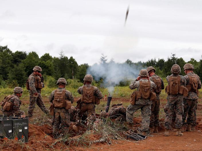 U.S. Marine Corps' members launch a mortar during a joint exercise with Japan's Ground Self Defense Force, named Northern Viper 17 at Hokudaien exercise area in Eniwa, on the northern island of Hokkaido, Japan.