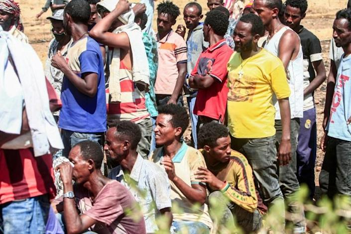 Ethiopians queue to receive supplies at the Um Raqub refugee camp in Sudan's eastern province of Gedaref