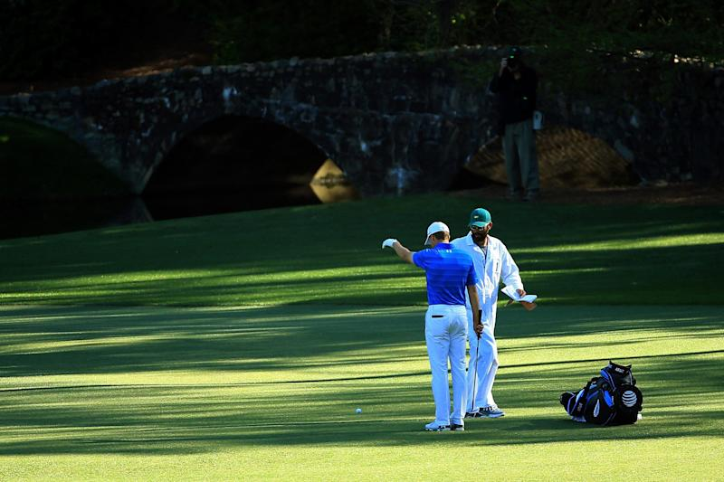 Jordan Spieth takes his first drop on the 12th hole during the final round of the 2016 Masters.