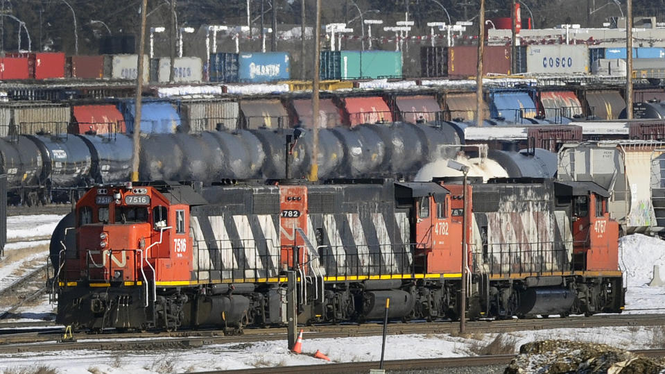 Locomotives move through the Canadian National (CN) railyards in Edmonton February 22, 2015. CN Railway said on Sunday it is meeting with Unifor, the union representing 4,800 of its mechanical, clerical and intermodal staff, and hoped to reach a negotiated settlement or an agreement to enter binding arbitration over their contract dispute. Canada's No. 1 railway had called for binding arbitration on Friday when it first announced it was preparing to lock out employees represented by the union, a move it said could come as soon as Monday. REUTERS/Dan Riedlhuber  (CANADA - Tags: BUSINESS TRANSPORT EMPLOYMENT)