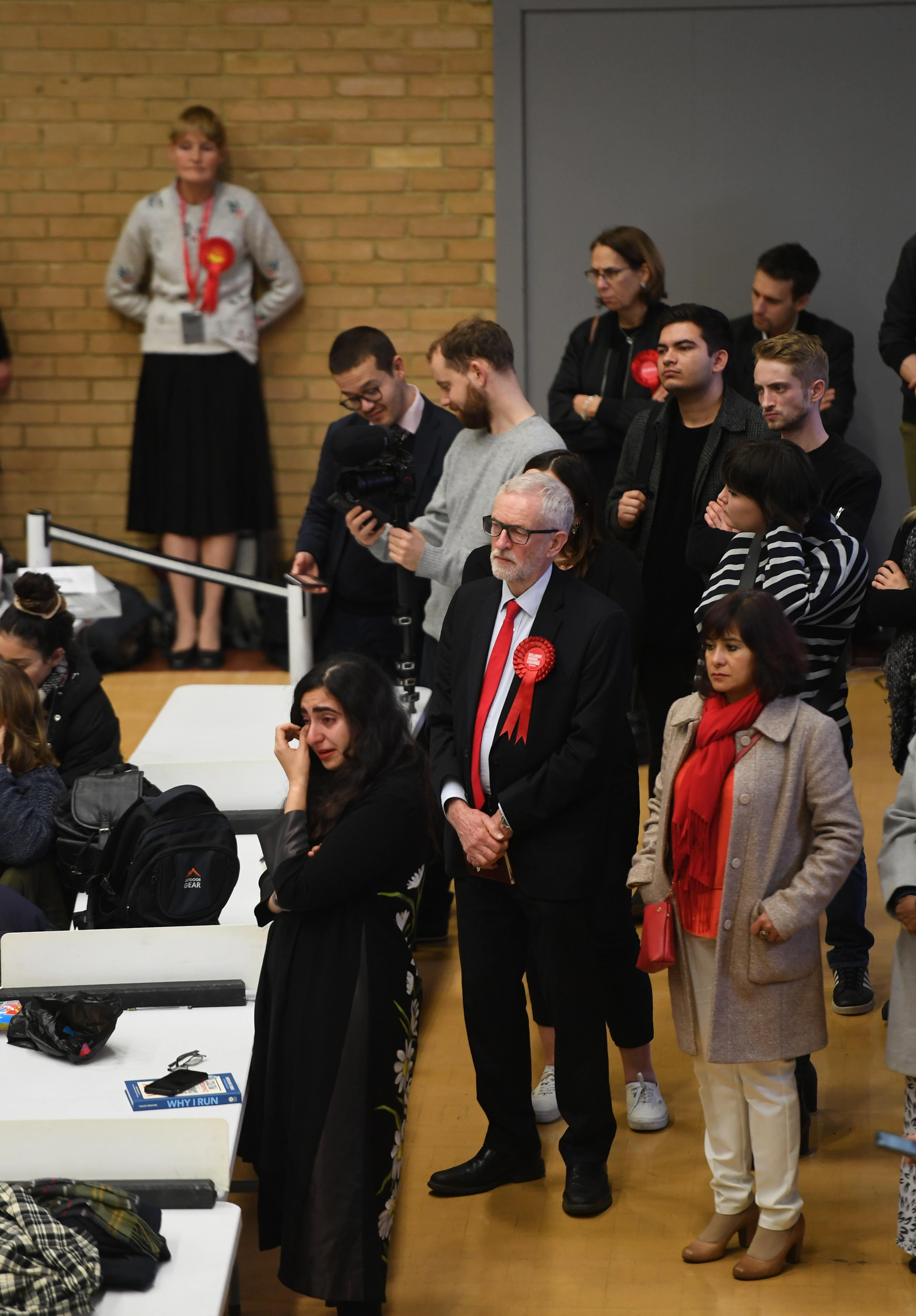 A woman appears emotional in front of Labour leader Jeremy Corbyn, with wife Laura Alvarez, at the count at Sobell Leisure Centre for the Islington North and South constituencies for the 2019 General Election. (Photo by Joe Giddens/PA Images via Getty Images)