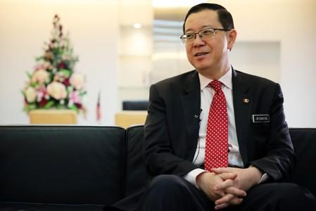 Malaysia's Finance Minister Lim Guan Eng speaks during an interview with Reuters in Putrajaya