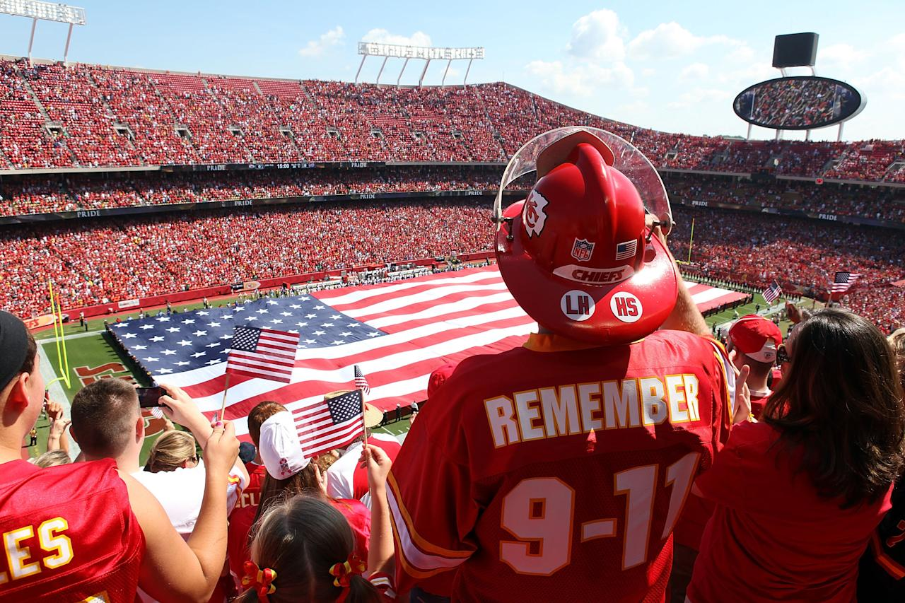KANSAS CITY, MO - SEPTEMBER 11:  A giant flag is unrolled during the National Anthem to commemorate the 10th anniversary of September 11th prior to the start of the game between the Buffalo Bills and the Kansas City Chiefs at Arrowhead Stadium on September 11, 2011 in Kansas City, Missouri.  (Photo by Jamie Squire/Getty Images)
