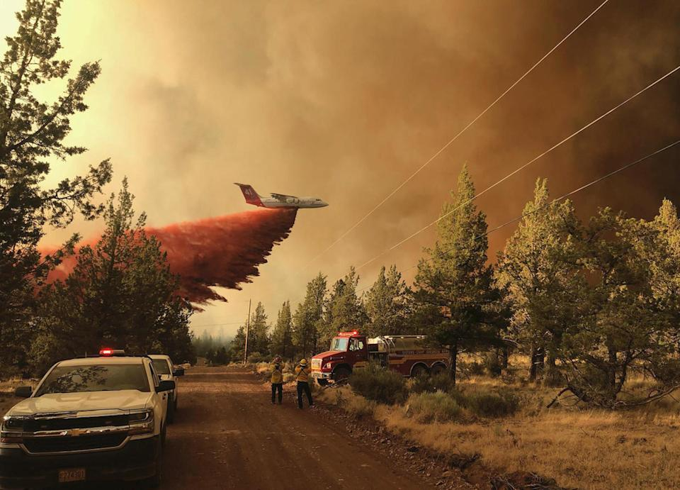A firefighting tanker drops retardant over the Grandview Fire on July 11, northeast of Sisters, Oregon.