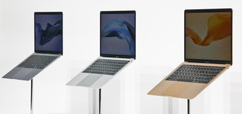 Apple's new MacBook Air computers are displayed during the company's showcase of new products Tuesday Oct. 30, 2018, in the Brooklyn borough of New York. (AP Photo/Bebeto Matthews)