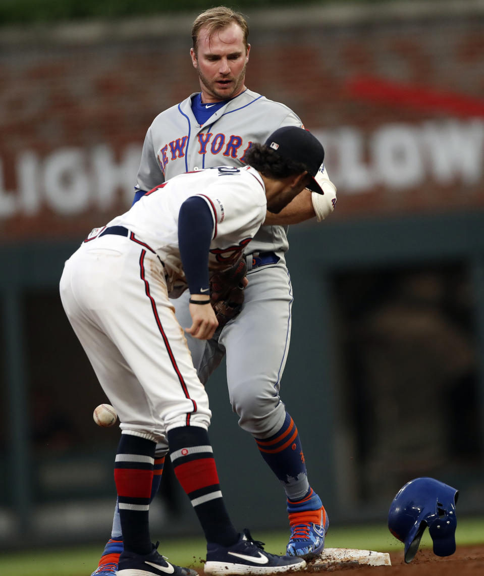 New York Mets' Pete Alonso (20) is safe at second base with a double as Atlanta Braves shortstop Dansby Swanson (7) attempts to make the tag in the third inning of a baseball game Tuesday, June 18, 2019, in Atlanta. New York won 10-2. (AP Photo/John Bazemore)