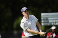 Davis Thompson watches his drive on the 11th tee during the second round of the Rocket Mortgage Classic golf tournament, Friday, July 2, 2021, at the Detroit Golf Club in Detroit. (AP Photo/Carlos Osorio)