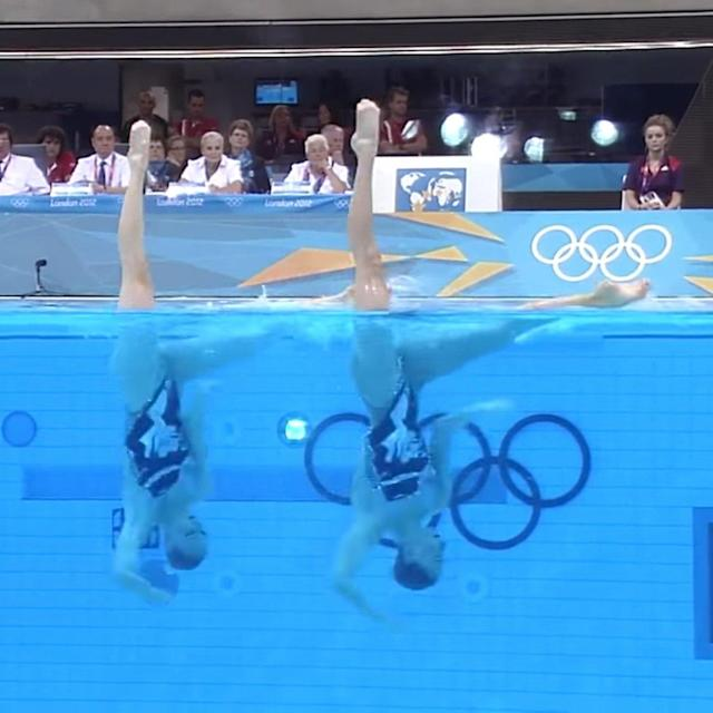 "At the 2012 Summer Olympics, Russian athletes Natalia Ishchenko and Svetlana Romashina paid tribute to the King of Pop in their synchronized swimming routine, and it was so iconic, we're bringing it back for good measure. The duet performed to Michael Jackson's hit ""They Don't Care About Us"" for their technical routine at the games in London, and they left judges in awe over their electric moves."