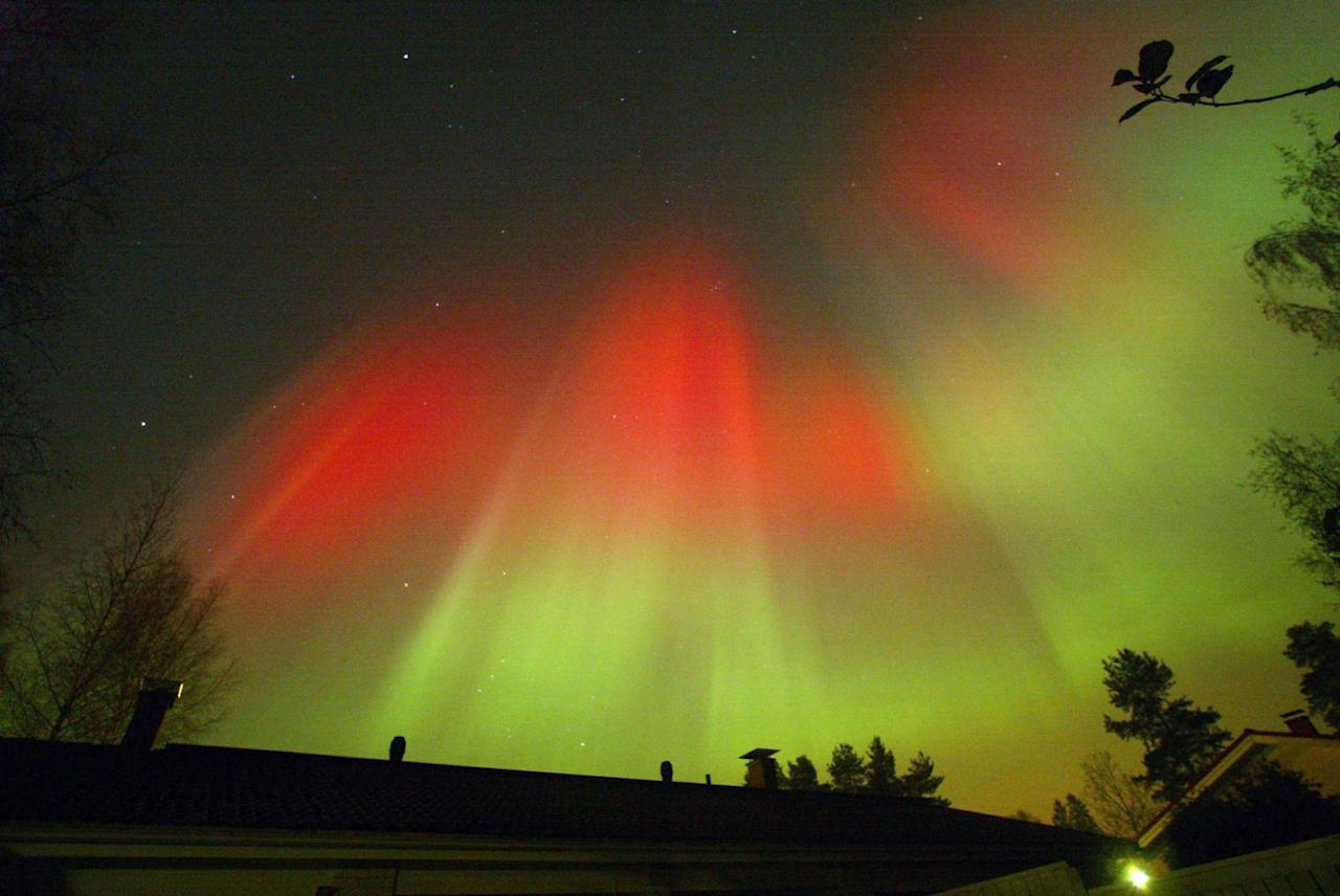 The aurora borealis is seen over the town of Hyvinkaa in southern Finland October 31, 2003. The aurora is very visible at the moment as a result of a second huge magnetic solar storm hitting the Earth on Thursday. FINLAND OUT, NO THIRD PARTY SALES REUTERS/ LEHTIKUVA / Pekka Sakki