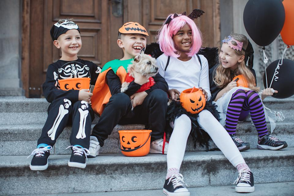 Celebrate Halloween with savings on your favorite candy (Image via Getty Images)