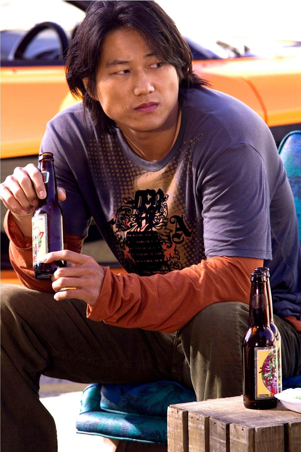 Sung Kang takes some time away from the action in 'Tokyo Drift' (Sidney Baldwin/Universal/Kobal/Shutterstock)