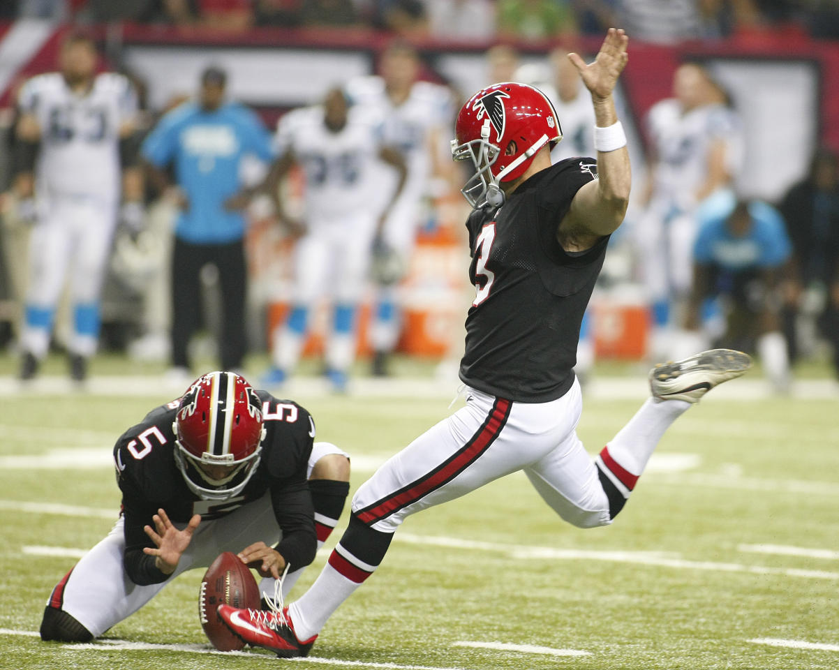 Atlanta Falcons holder Matt Bosher holds the ball as kicker Matt Bryant (2), kicks the winning field goal against the Carolina Panthers in the second half of their NFL football game in Atlanta, Georgia September 30, 2012.   REUTERS/Tami Chappell   (UNITED STATES - Tags: SPORT FOOTBALL TPX IMAGES OF THE DAY)