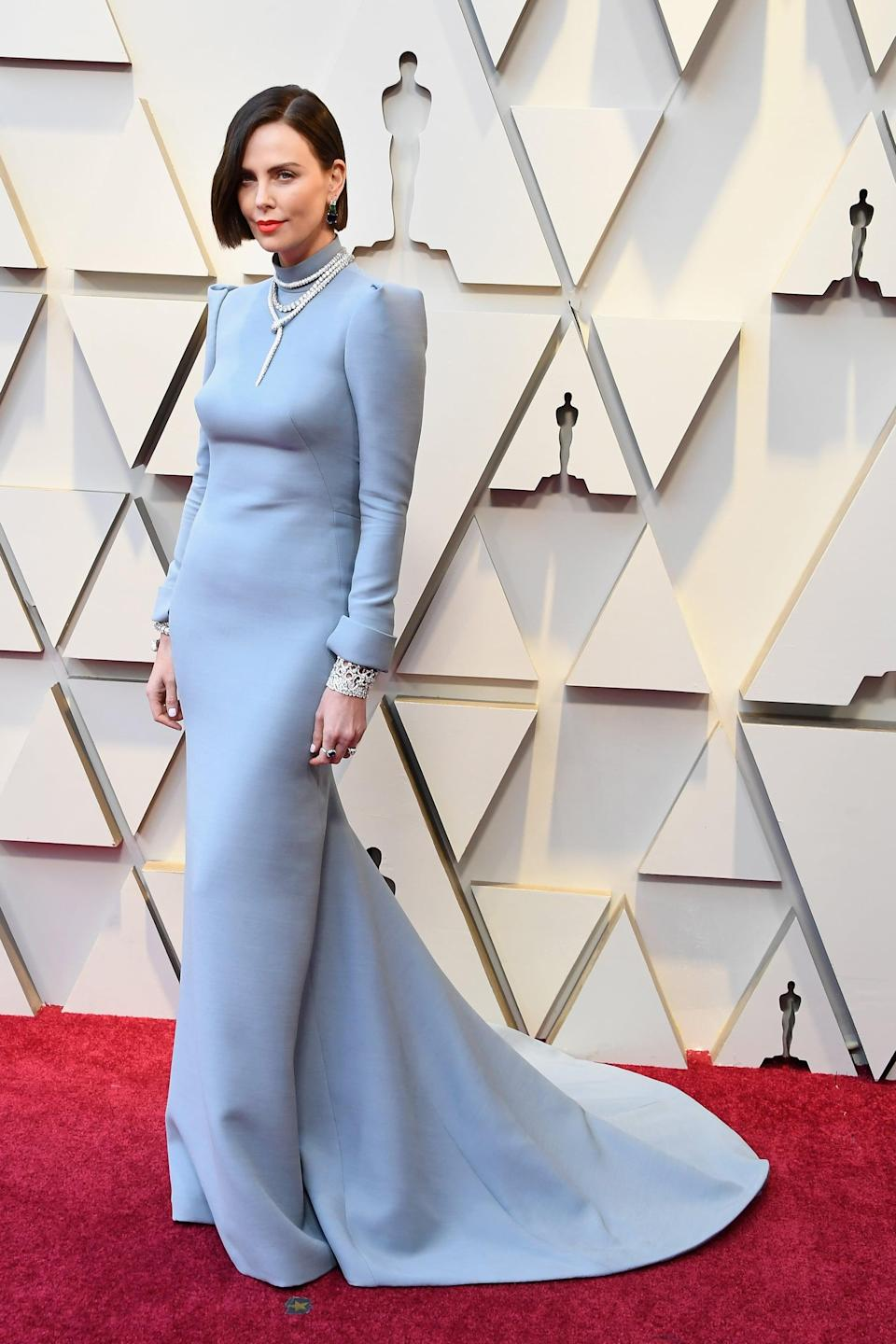"""<p><a rel=""""nofollow noopener"""" href=""""https://www.popsugar.com/fashion/Charlize-Theron-Dior-Dress-Oscars-2019-45832797"""" target=""""_blank"""" data-ylk=""""slk:Wearing a Dior Haute Couture dress with Bulgari jewels and Jimmy Choo shoes"""" class=""""link rapid-noclick-resp"""">Wearing a Dior Haute Couture dress with Bulgari jewels and Jimmy Choo shoes</a>.</p>"""