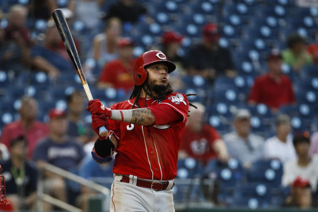 Cincinnati Reds' Freddy Galvis watches his two-run homer during the ninth inning of a baseball game against the Washington Nationals at Nationals Park, Wednesday, Aug. 14, 2019, in Washington. The Nationals won 17-7. (AP Photo/Alex Brandon)