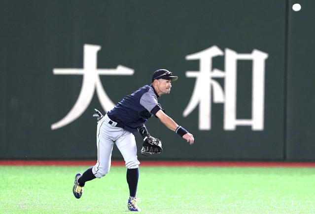 Seattle Mariners' Ichiro Suzuki warms up during his team's practice at Tokyo Dome in Tokyo Saturday, March 16, 2019. The Mariners will play in a two-baseball game series against the Oakland Athletics to open the Major League season on March 20-21. (AP Photo/Eugene Hoshiko)