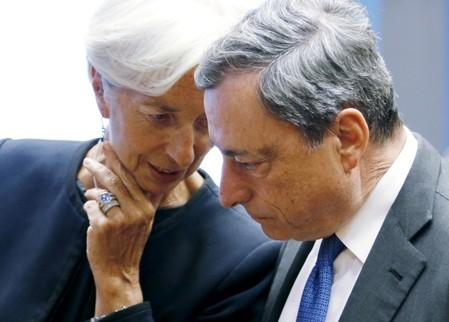 IMF Managing Director Lagarde talks to ECB President Mario Draghi during a Euro zone finance ministers meeting in Luxembourg,