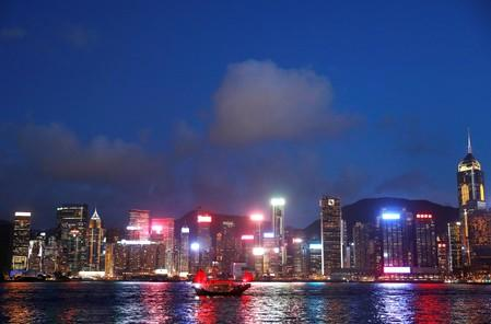 Exclusive: China prods state firms to boost investment in crisis-hit Hong Kong