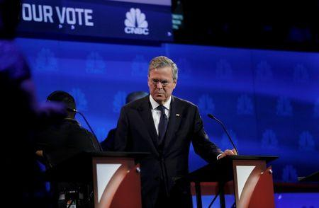 Republican U.S. presidential candidate and former Florida Governor Jeb Bush pauses at his podium in the midst of a commercial break at the 2016 U.S. Republican presidential candidates debate held by CNBC in Boulder