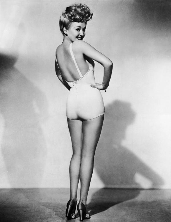 "<div class=""caption-credit""> Photo by: Getty</div><div class=""caption-title""></div>Pin-up icon Betty Grable's legs made her the highest paid celebrity from 1941 to 1945. Posters of her famous gams lined the walls of many a soldier during WWII. But it wasn't all for the boys. She insured her famous assets for <a rel=""nofollow"" target="""" href=""http://www.time.com/time/specials/packages/article/0,28804,2015171_2015172_2014872,00.html"">$1 million</a>, an astronomical figure for that time. In 1948, she pushed aside the traditional handprint at Grauman's Chinese Theater in Los Angeles and left imprints of her legs in the concrete instead."