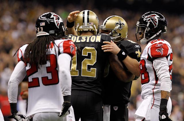 NEW ORLEANS, LA - DECEMBER 26: Wide receiver Marques Colston #12 of the New Orleans Saints celebrates with quarterback Drew Brees #9 after Colston catches an eight-yard touchdown pass in the second quarter against the Atlanta Falcons at the Mercedes-Benz Superdome on December 26, 2011 in New Orleans, Louisiana. (Photo by Chris Graythen/Getty Images)