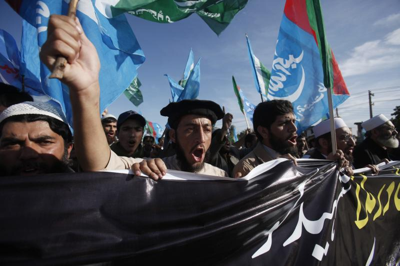 Supporters of Pakistani political and religious party Jamat-e-Islami chant slogans as they protest in Peshawar