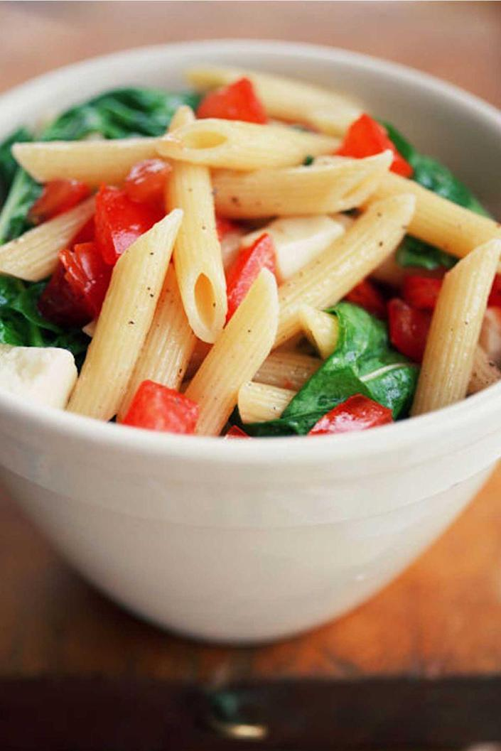 """<p>Bring this pasta salad to a picnic, barbecue, or potluck - it's a satisfying side that everyone will love, with large chunks of ripe tomatoes, fresh basil, tangy red onion, and dried oregano.</p><p><a href=""""https://www.womansday.com/food-recipes/food-drinks/recipes/a11221/tomato-basil-pasta-salad-recipe-122548/"""" rel=""""nofollow noopener"""" target=""""_blank"""" data-ylk=""""slk:Get the recipe for Tomato-Basil Pasta Salad."""" class=""""link rapid-noclick-resp""""><u><em>Get the recipe for Tomato-Basil Pasta Salad.</em></u></a></p>"""