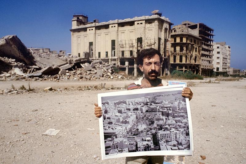 A picture from 1990, at the end of Lebanon's 15-year civil war, shows a street vendor in downtown Beirut selling posters of the same place in the late 1960s (AFP Photo/PATRICK BAZ)