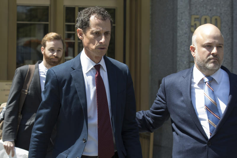 FILE - In this May 19, 2017, file photo, former U.S. Rep. Anthony Weiner, left, leaves Federal court in New York after pleading guilty to a charge of transmitting sexual material to a minor. Weiner is to be sentenced Monday, Sept. 25, 2017, for sending obscene material to a 15-year-old girl in 2016. (AP Photo/Mary Altaffer, File)