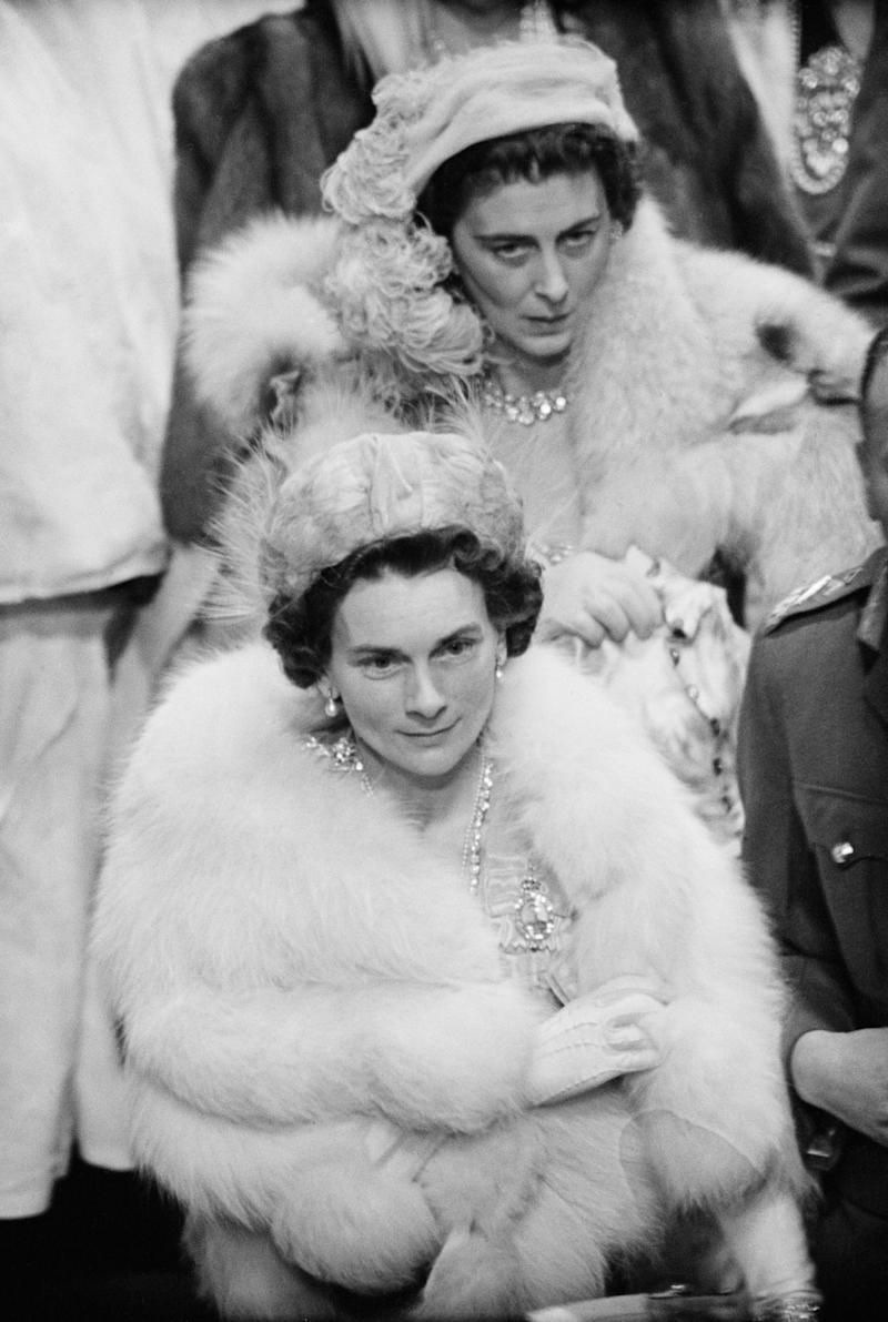 Two members of the British royal family -- Princess Marina, Duchess of Kent (back), and Princess Alice, Duchess of Gloucester -- arrive at Westminster Abbey.