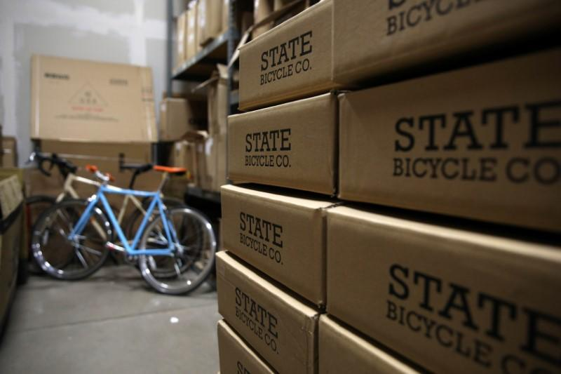Bicycles are boxed up to be shipped at State Bicycle in Tempe