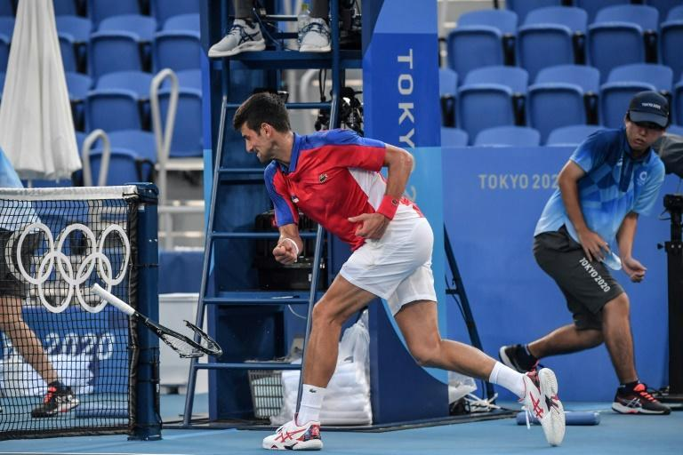 Novak Djokovic threw one racquet into the stands and smashed another against a net post