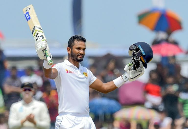 Sri Lanka captain Dimuth Karunaratne celebrates after scoring his century