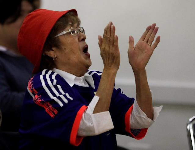 A Japanese descendant reacts as she watches the broadcast of the World Cup Group H soccer match between Japan and Colombia at Liberdade, a Japanese neighbourhood in Sao Paulo, Brazil June 19, 2018. REUTERS/Paulo Whitaker