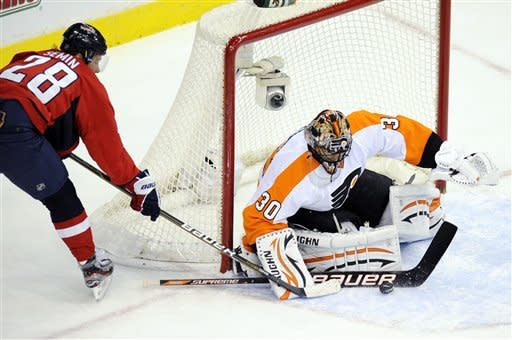 Philadelphia Flyers goalie Ilya Bryzgalov (30), of Russia, stops the puck against Washington Capitals left wing Alexander Semin (28), of Russia, during the first period of an NHL hockey game, Tuesday, Dec. 13, 2011, in Washington. (AP Photo/Nick Wass)