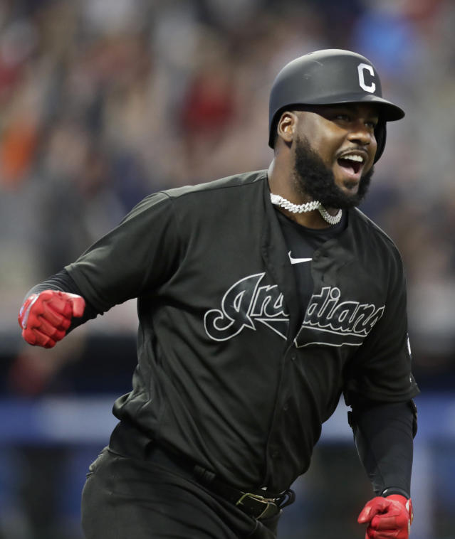 Cleveland Indians' Franmil Reyes celebrates after hitting a three-run home run during the third inning of the team's baseball game against the Kansas City Royals, Saturday, Aug. 24, 2019, in Cleveland. (AP Photo/Tony Dejak)